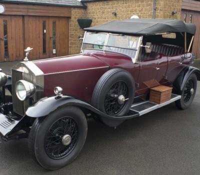 Maroon Rolls Royce